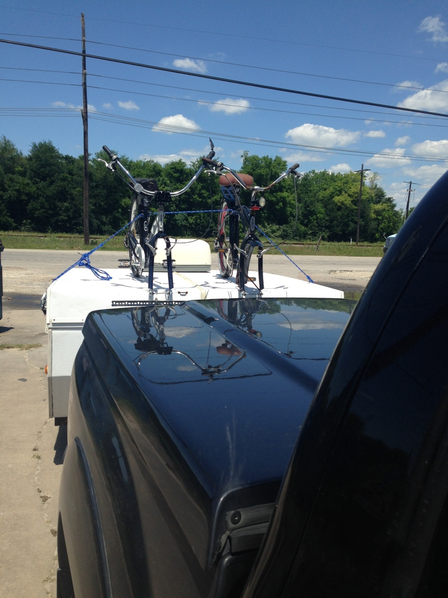 View from truck of the pop up camper bicycle rack